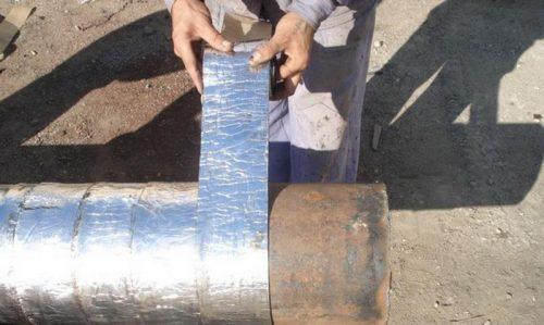 Гидроизоляция стальной трубы липкой фольгированной лентой