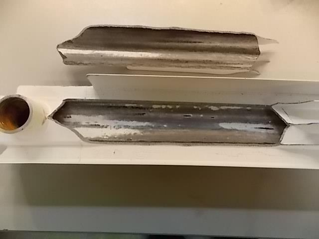 Алюминиевая батарея после краткосрочного повышения давления в отопительной системе